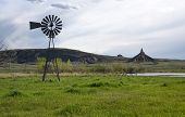 stock photo of nebraska  - Old windmill water pump at Chimney Rock in western Nebraska - JPG