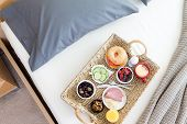 picture of bed breakfast  - High Angle View of Wicker Breakfast Tray on Unmade Bed in Hotel Room - JPG