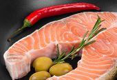 foto of salmon steak  - Frying pan with salmon steak - JPG