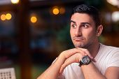 picture of cynicism  - Funny expressive man waiting in a bar - JPG
