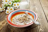 picture of buckwheat  - Buckwheat porridge with milk in the bowl on the table - JPG