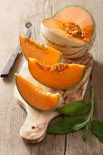 pic of cantaloupe  - cantaloupe melon sliced on wooden background - JPG