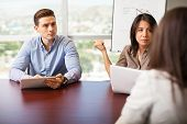 stock photo of pov  - Couple of human resources workers interviewing a woman for a job position  - JPG