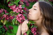 picture of allergies  - Young spring fashion woman in spring garden Springtime Summertime Trendy girl in the flowering trees in then at sunset in spring summer landscape background Allergic to pollen of flowers Allergy 