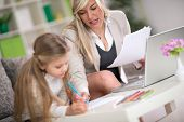picture of homework  - daughter doing homework with mom - JPG