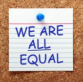 stock photo of all-inclusive  - The phrase We Are All Equal in blue text on an index card pinned to a cork notice board as a reminder - JPG