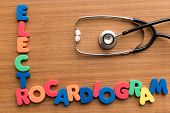image of electrocardiogram  - electrocardiogram colorful medical word and stethoscope on the wooden background - JPG