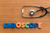pic of endoscopy  - endoscope colorful medical word and stethoscope on the wooden background - JPG