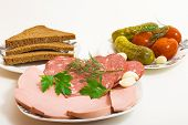 stock photo of pickled vegetables  - Sausage with bread and pickled vegetables on a white background - JPG