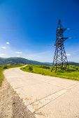 picture of power transmission lines  - High voltage electric power lines tower near the road in mountains - JPG