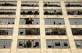 stock photo of windows doors  - Industrial building broked down doors and windows - JPG