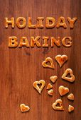 stock photo of baps  - Letters of dough and hearts on the wooden table - JPG