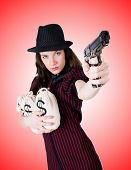 foto of handgun  - Woman gangster with handgun against the gradient - JPG