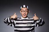 image of prison uniform  - Funny prisoner isolated on gray - JPG