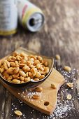 picture of salt-bowl  - salted peanut nuts in a bowl on the old wooden background - JPG