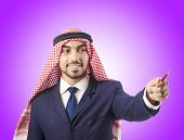 picture of arab man  - Arab man pressing virtual buttons - JPG