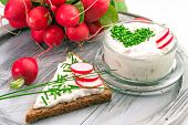 picture of chive  -  A bowl with curd and radish and a heart shaped chives decoration and brown bread - JPG