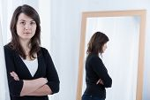 picture of pullovers  - Woman in black pullover standing with crossed arms - JPG