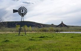 stock photo of western nebraska  - Old windmill water pump at Chimney Rock in western Nebraska - JPG