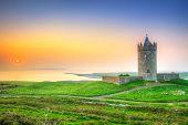 Beautiful irish castle near Atlantic ocean at sunset, Co. Clare poster