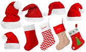Santa Claus hats and Christmas stocking isolated on white poster