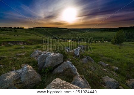 poster of Night Glacial Stones In Field Landscape Under Moonlight Halo