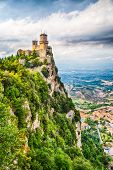 The Guaita Tower Is The Most Famous Tower Of A Group Of 3 Towers In San Marino. It Is Located On Mon poster