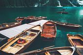 Traditional Wooden Rowing Boats On Italian Alpine Braies Lake At Summer. Lago Di Braies Is Largest N poster