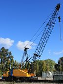 pic of boom-truck  - small yellow and black construction crane with a long boom - JPG