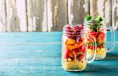 Healthy Homemade Mason Jar Salad With Chickpea, Corn, Carrots, Cucumbers, Bell Peppers, Radish, Arug poster