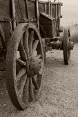 stock photo of wagon wheel  - A wonderful perspective on an old covered wagon that has obviously been sitting around for a while - JPG