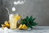 Pineapple And Ice With Splash On Wood poster