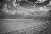 Dusty Bumpy Road Through Desert Of Namibia As Storm Clouds Collect Overhead Creating Contrasting Sky poster