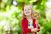 Little Girl With Colorful Candy Lollipop poster