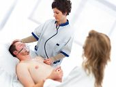 pic of cpr  - Young man being checked by a doctor for vital signs - JPG