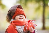 Cute Laughing Baby In Autumn Clothes. Child In Knitted Hats And Scarf. Orange Animal Is Fox. Concept poster