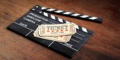 Movie Cinema Concept. Cinema Old Type Tickets Beige Isolated On A Movie Clapper And A Wooden Backgro poster