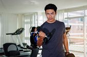 Muscular Asian Young Handsome Man Doing Exercises With Dumbbell For Good Healthy In Fitness Gym At M poster