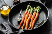 Cooking Carrots. Fresh Carrots Ready For Cooking On A Pan. Roast Carrots With Olive Oil And Honey poster