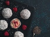 Raw Vegan Lamington Bliss Balls With Raspberries Chia Jam On Dark Background. No Baked Healthy Vegan poster