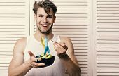 Fitness Lifestyle And Regime Idea. Man With Unshaven Face Holds Bowl And Fork With Measuring Tape. W poster