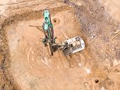 Rotary Drill At Construction Site. Heavy Construction Machinery. Aerial View poster