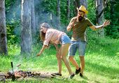 Man Bearded Hipster Looks At Sexy Female Buttocks. Seductive Position. Girl Bent Down To Fire While  poster