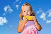 Little Girl Eating Cooked Sweet Corn poster