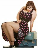 image of curvaceous  - Sexy plus size woman sitting on stack of suitcases - JPG
