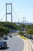 ISTANBUL - JUL 3: Landscape with wide road and cars against Ataturk Bridge (Bosphorus Bridge) on Jul
