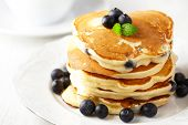 stock photo of buttermilk  - Stack of pancakes with fresh blueberry - JPG