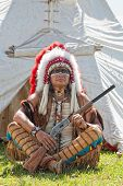 stock photo of reconstruction  - North American Indian in full dress - JPG