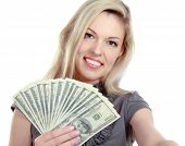 A young woman with dollars in her hands, isolated on white background