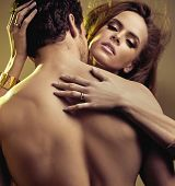 foto of seduce  - Close up portrait of young lovers - JPG